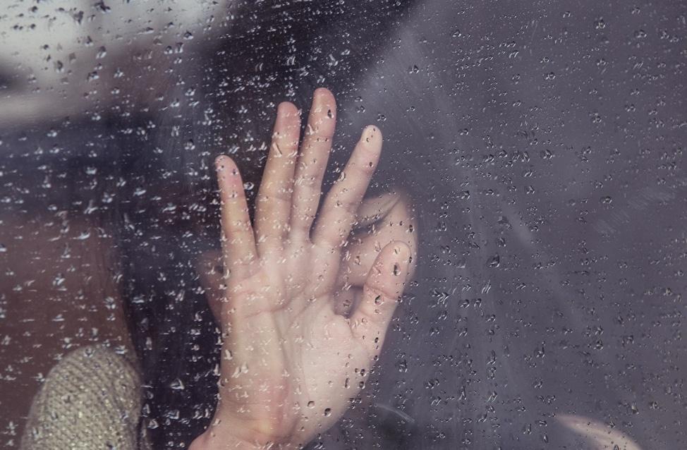 woman rain window
