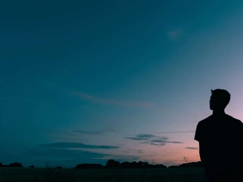 man alone outside sky
