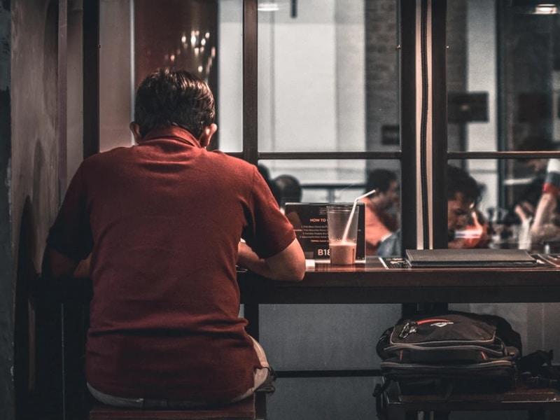 man sitting alone in bar