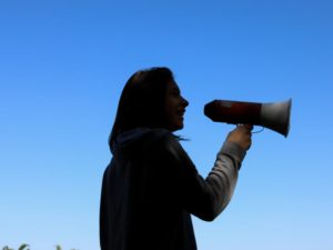 woman speak up megaphone
