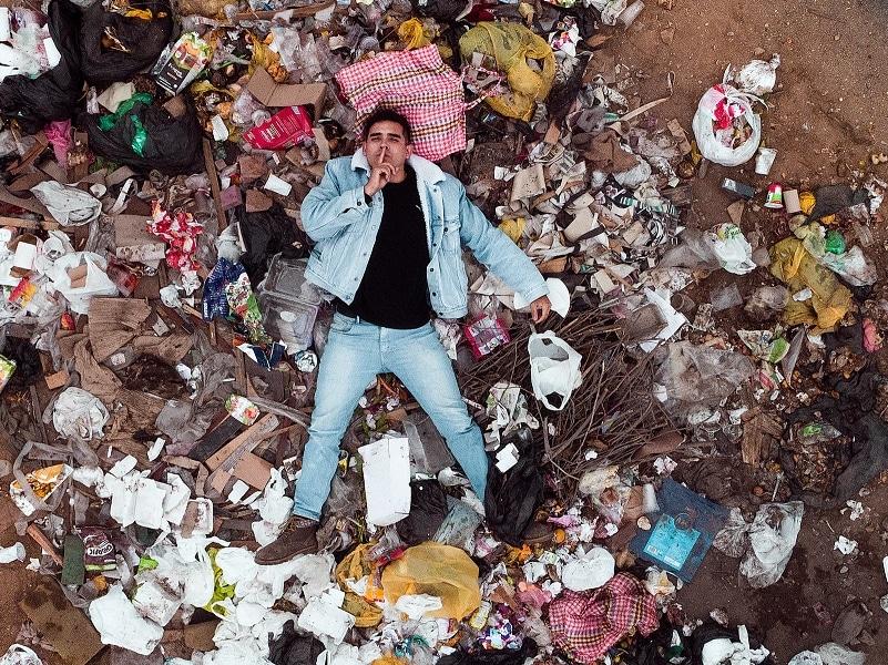 man in trash