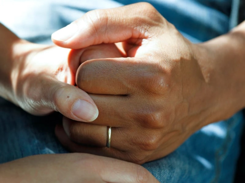 care touching hands compassion