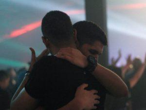 two men hugging