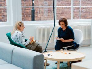 2 women meeting writing notes