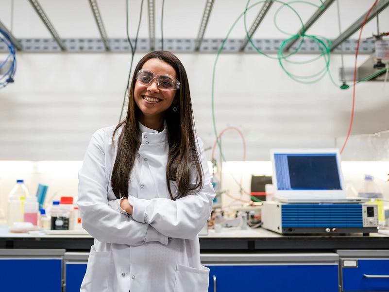 woman lab coat smiling