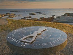 sundial near ocean